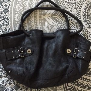 Black Cole Haan hand bag purse w/silver